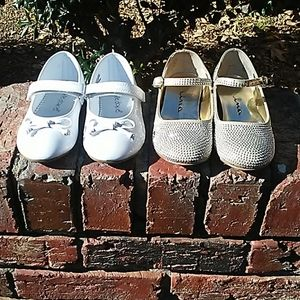 Two pairs of little girls shoes
